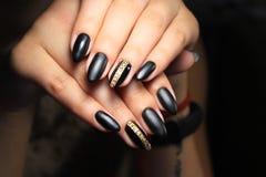 tratamento de mãos preto elegante Fotografia de Stock Royalty Free
