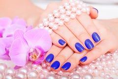 Tratamento de mãos e pedicure Fotos de Stock Royalty Free