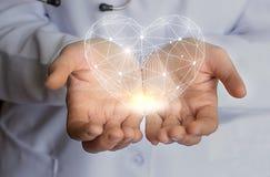 Tratamiento del cuidado y ayuda modernos del corazón Fotos de archivo