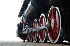 Trate las ruedas del tren con vapor Imagen de archivo