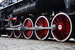 Trate las ruedas del tren con vapor Fotografía de archivo
