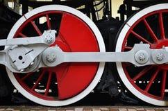 Trate las ruedas del tren con vapor Imagen de archivo libre de regalías