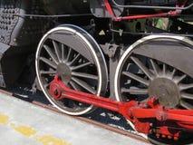 Trate las ruedas del tren con vapor Imágenes de archivo libres de regalías