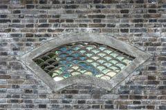 Trational-Ziegelsteinfenster im chinesischen Garten Stockfotografie