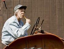 Trator e fazendeiro do vintage Fotografia de Stock Royalty Free