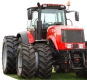 Trator vermelho novo com rodas dobro Imagem de Stock Royalty Free