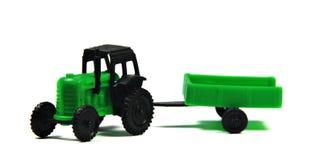 Trattore del giocattolo con il carrello Fotografia Stock Libera da Diritti