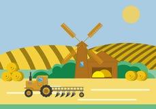 Trattore del mulino a vento del granaio dell'azienda agricola Fotografia Stock