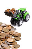 Trattore verde che rastrella sulle monete Immagine Stock Libera da Diritti