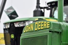 Trattori e logo di John Deere Immagini Stock