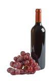 Traube und Flasche Rotwein Stockfoto