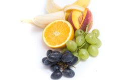 Trauben, Pfirsiche, Bananen und Orange Lizenzfreie Stockfotografie