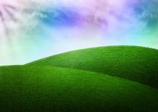 Traum des Fantasiehintergrundhimmel-Regenbogengrases Stockfotografie