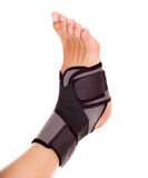 Trauma of ankle brace. Trauma of ankle in brace. Isolated on white Royalty Free Stock Photos