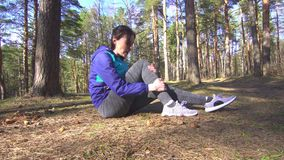 Girl Leg injury on the running training, stretching