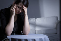 Trauma after husband's death. Crying widow having trauma after her husband's death Royalty Free Stock Images