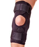 Trauma of knee in brace. Royalty Free Stock Photos