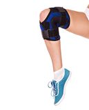 Trauma of knee in brace. Isolated Stock Photo