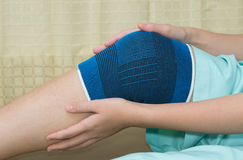 Trauma of knee in brace  during rehabilitation Royalty Free Stock Photo