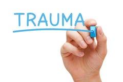 Trauma scritto a mano con l'indicatore blu Fotografie Stock