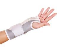 Trauma of wrist in brace. Isolated Stock Photos