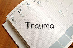 Trauma write on notebook Stock Image