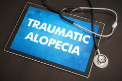 Traumatic alopecia (cutaneous disease) diagnosis medical concept. On tablet screen with stethoscope Stock Photos