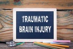 Traumatic brain injury. Chalkboard on a wooden background.  stock photo