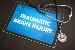 Traumatic brain injury (neurological disorder) diagnosis medical. Concept on tablet screen with stethoscope royalty free stock image