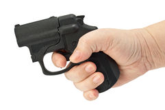 Traumatic pistol in his hand Royalty Free Stock Photography