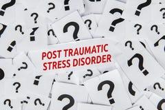 Traumatischer Belastungssyndromtext des Postens über Papieren lizenzfreies stockfoto
