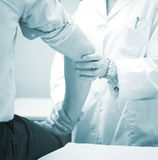 Traumatologist orthopedic surgeon doctor examining patient Royalty Free Stock Photos