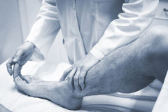 Traumatologist orthopedic surgeon doctor examining patient Royalty Free Stock Image