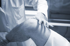 Traumatologist orthopedic surgeon doctor examining patient Royalty Free Stock Photos