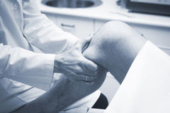 Traumatologist orthopedic surgeon doctor examining patient Stock Photos