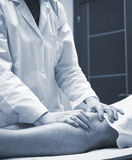 Traumatologist orthopedic surgeon doctor examining patient Stock Photo