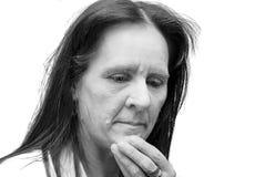 Traurige fällige Frau Stockfotografie