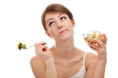Traurige Frau auf Diät mit Gemüse Stockfoto