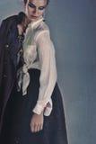 Traurige Frau mit Mantel Stockbilder
