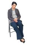 Traurige Geschäftsfrau auf Stuhl Lizenzfreie Stockfotos