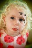 Traurige Gesichtsmalerei des kleinen Mädchens Lizenzfreies Stockfoto