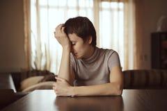 Traurige junge Frau Stockfotografie