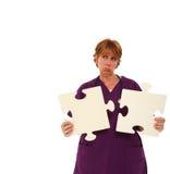 Traurige Krankenschwester-Holding-Puzzlespiel-Stücke Stockfotos