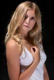 Traurige recht blonde Frau Stockfoto