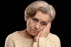 traurige schöne ältere Frau Lizenzfreie Stockfotografie