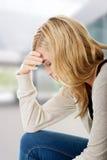 Traurige und deprimierte Frau Lizenzfreie Stockfotografie