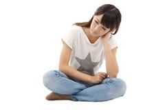 Traurige und des Tiefstands junge Frau Stockfotos