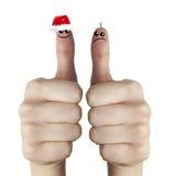 Traurige und glückliche Weihnachtsmann-Finger Lizenzfreies Stockfoto