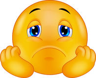 Trauriger Emoticon smiley der Karikatur Stockfotos