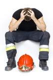 Trauriger Feuerwehrmann Lizenzfreies Stockfoto